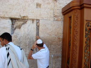 I'm trying to insert a prayer into the Western Wall AND keep my paper yamaka from blowing away