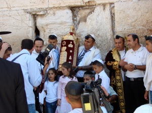 a family celebrating a bar mitzvah at the wall